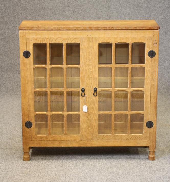 A HORACE KNIGHT (BALK) GLAZED ADZED OAK DISPLAY CABINET, the moulded edged top over two multi
