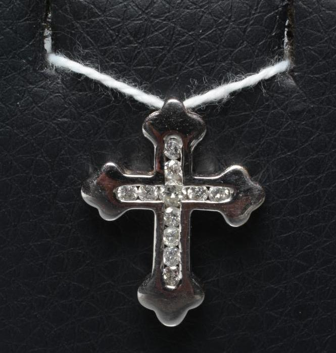 A SMALL DIAMOND CROSS PENDANT, the Fleury type cross channel set with eleven small brilliant cut