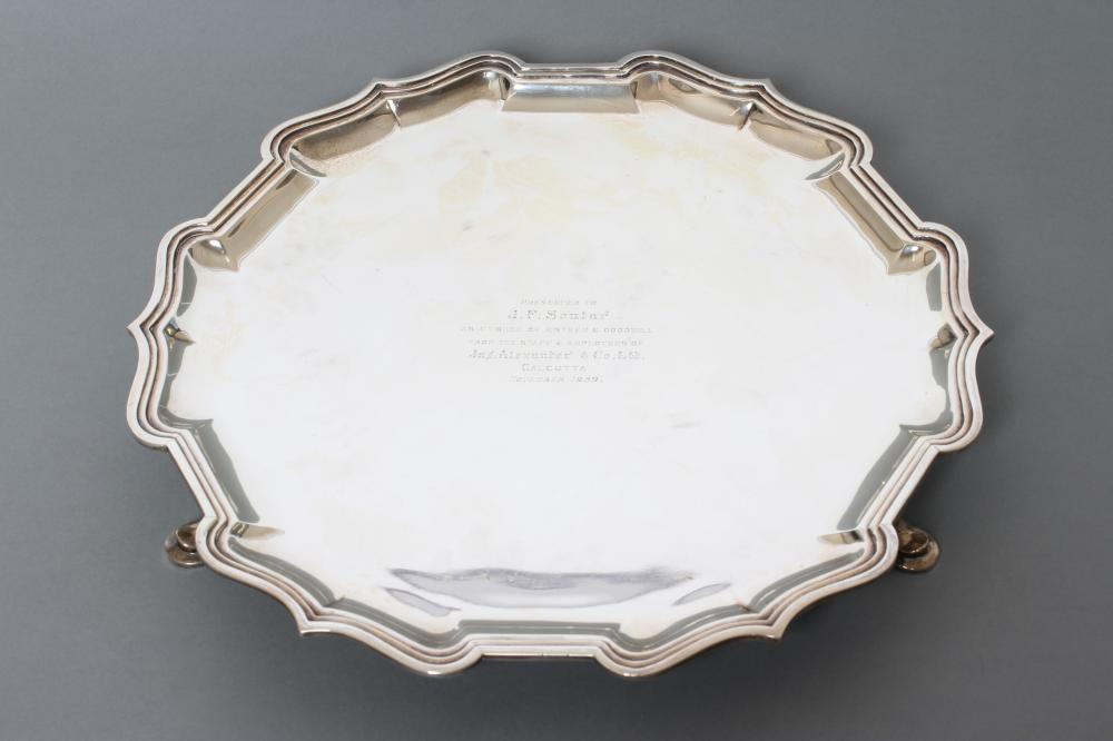 A STERLING SILVER SALVER, maker Hamilton & Co., India, c.1939, of shaped circular form with pie-