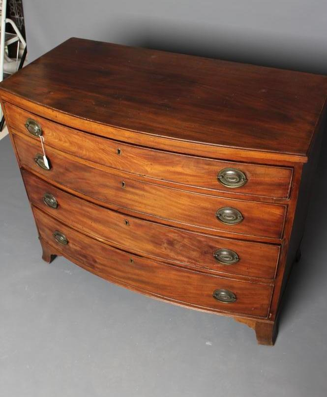 A REGENCY MAHOGANY BOWED CHEST, early 19th century, of four graduated cockbeaded drawers with - Image 2 of 2