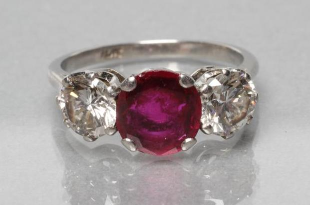 A THREE STONE RUBY AND DIAMOND RING, the circular facet cut ruby claw set and flanked by two - Image 2 of 10