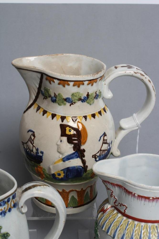 FOUR PRATTWARE JUGS, early 19th century, variously moulded in relief with a bust portrait of Nelson, - Image 2 of 4