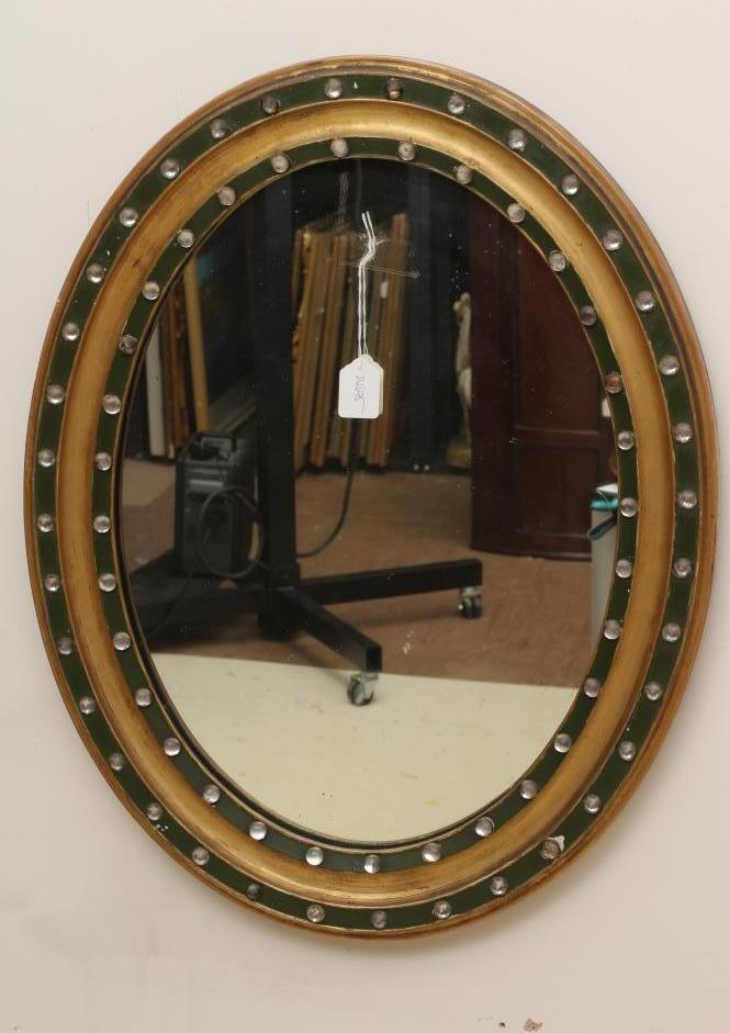 A LATE GEORGIAN GILT WOOD PIER GLASS, early 19th century, the oval plate within a moulded surround