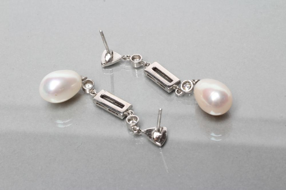A PAIR OF PEARL AND DIAMOND DROP EAR STUDS, the oval cultured pearls drilled and pendant from shaped - Image 2 of 2