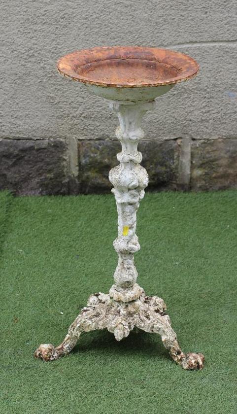 A VICTORIAN CAST IRON BIRD BATH, the circular bowl raised on foliate baluster stem, on conforming