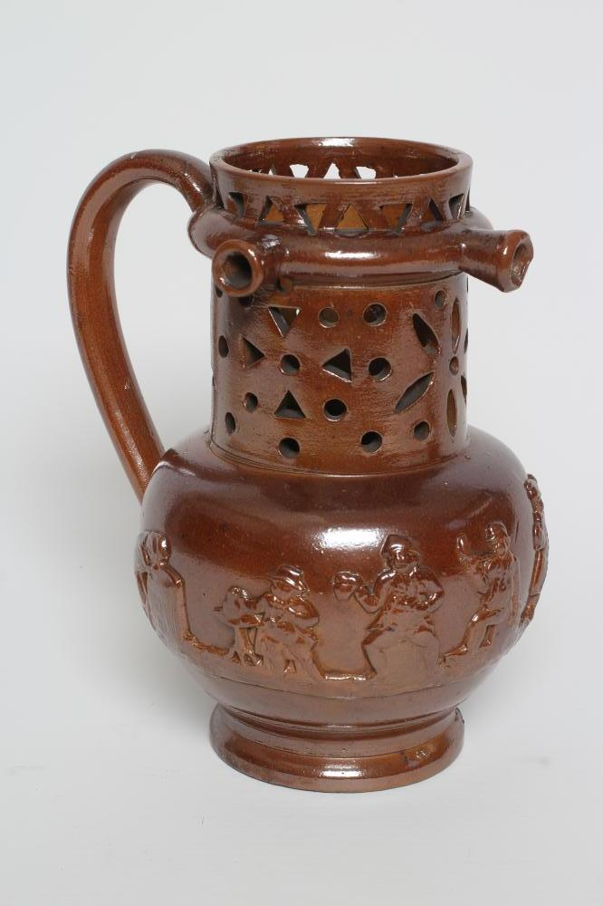 A VICTORIAN BROWN SALT GLAZED STONEWARE PUZZLE JUG of typical form with three spouts, the sprigged
