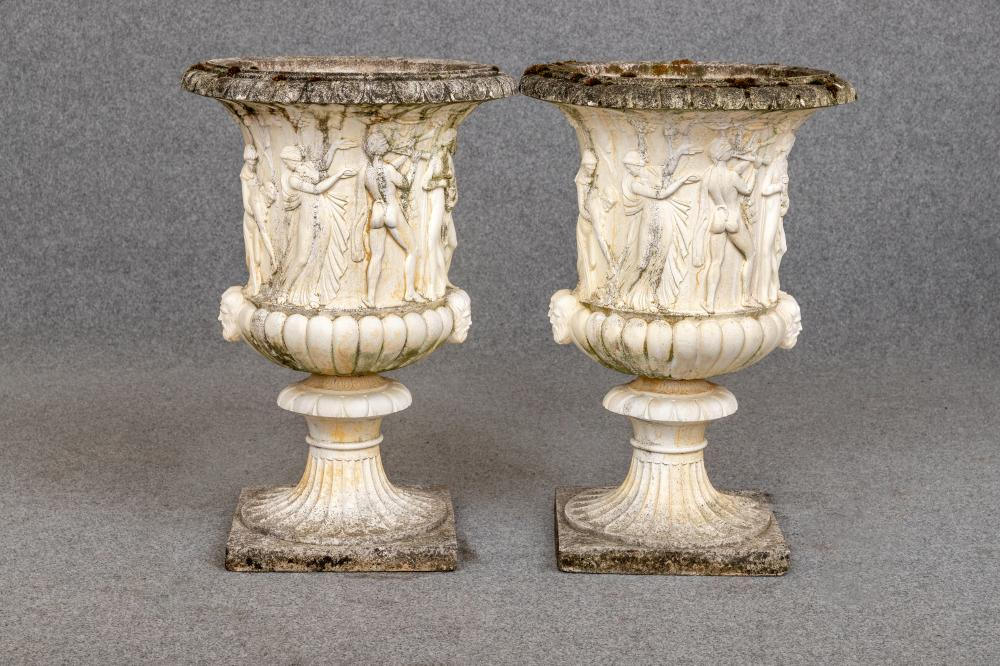 A LARGE PAIR OF COMPOSITION STONE MEDICI STYLE URNS, the ovolo rim over frieze of classical figures,