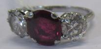 A THREE STONE RUBY AND DIAMOND RING, the circular facet cut ruby claw set and flanked by two - Image 7 of 10