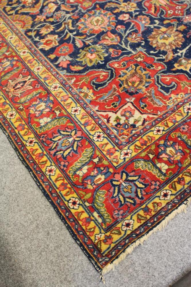 A PERSIAN RUG, the navy blue floral field with similar red and ivory gul, conforming spandrels, - Image 2 of 3