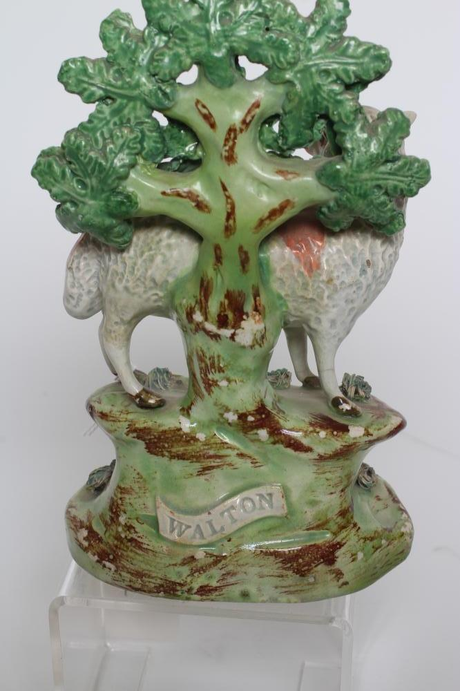 A WALTON PEARLWARE SHEEP, early 19th century, modelled standing against bocage on a shaped - Image 5 of 5