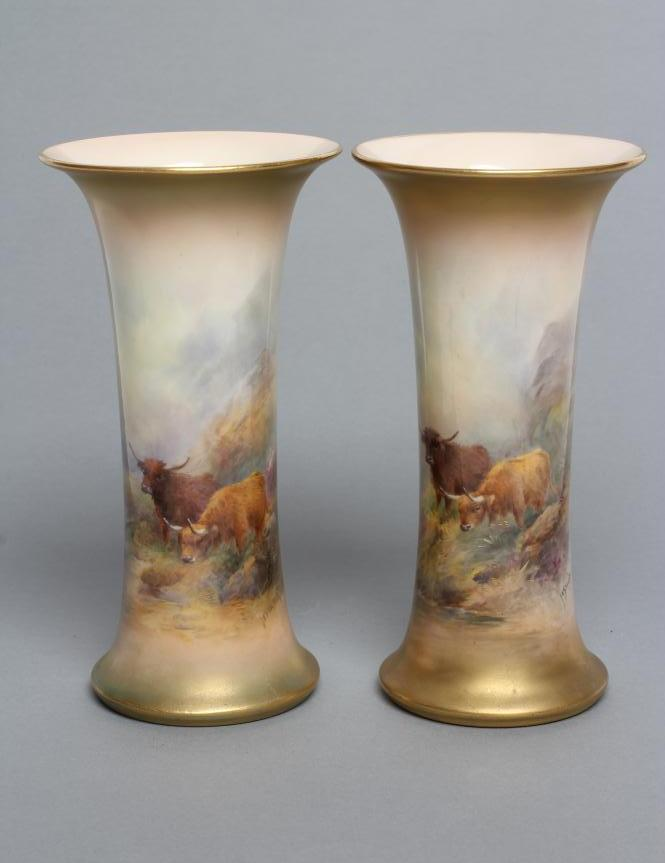 A PAIR OF ROYAL WORCESTER CHINA VASES, c.1921, of waisted cylindrical form, painted in polychrome