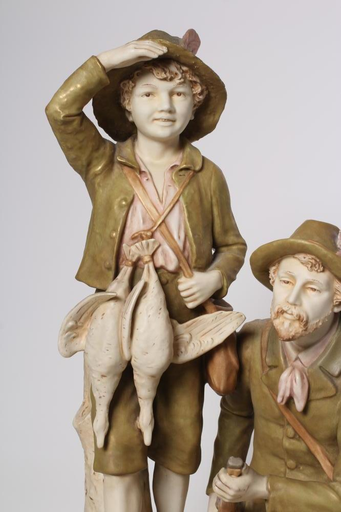 A ROYAL DUX FIGURE GROUP, early 20th century, the hunter kneeling and holding a rifle, his young - Image 2 of 12