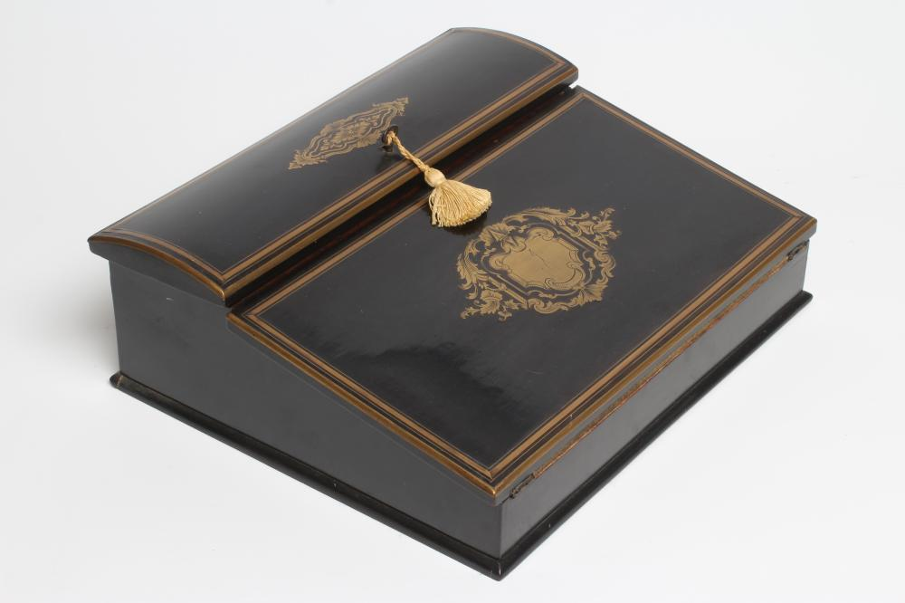 AN EBONY AND BRASS INLAID WRITING BOX, mid 19th century, of oblong form, the folding slope inlaid