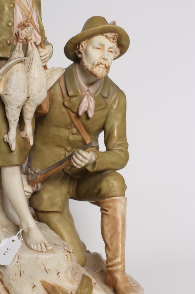 A ROYAL DUX FIGURE GROUP, early 20th century, the hunter kneeling and holding a rifle, his young - Image 3 of 12