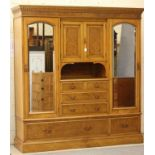 AN ASH AND BURR MAPLE TRIPLE WARDROBE, c.1900, the dentil and gadroon moulded cornice over a pair of