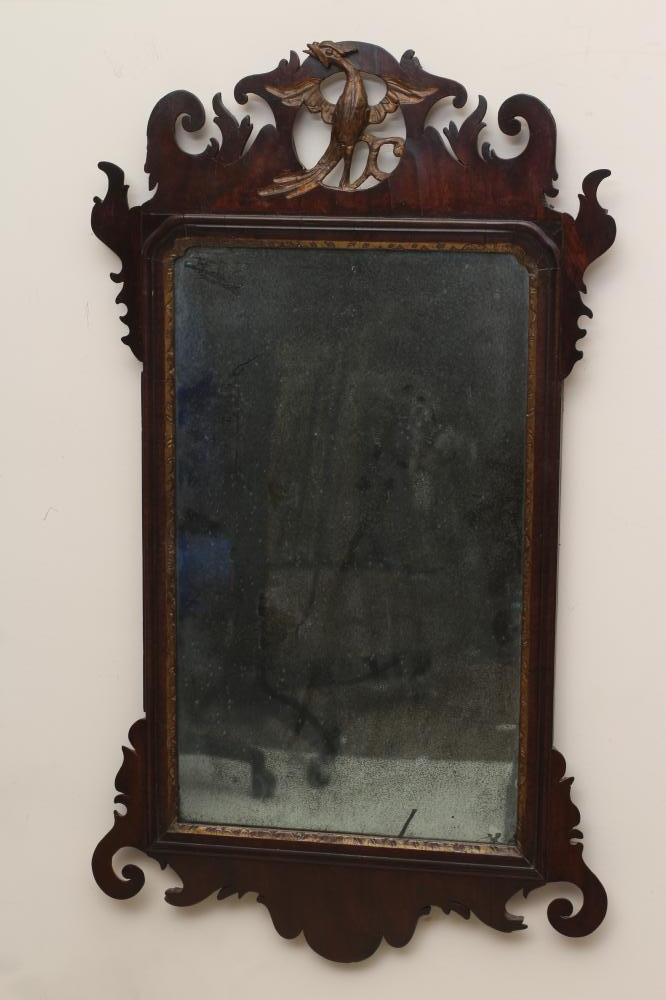 A GEORGIAN MAHOGANY FRET FRAMED PIER GLASS, mid 18th century, the oblong plate within a moulded