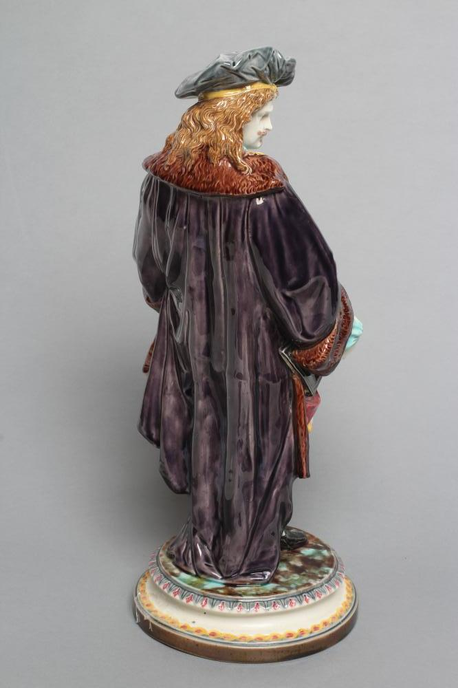 A CONTINENTAL MAJOLICA FIGURE, late 19th century, modelled as a gentleman wearing a grey hat, fur - Image 2 of 3