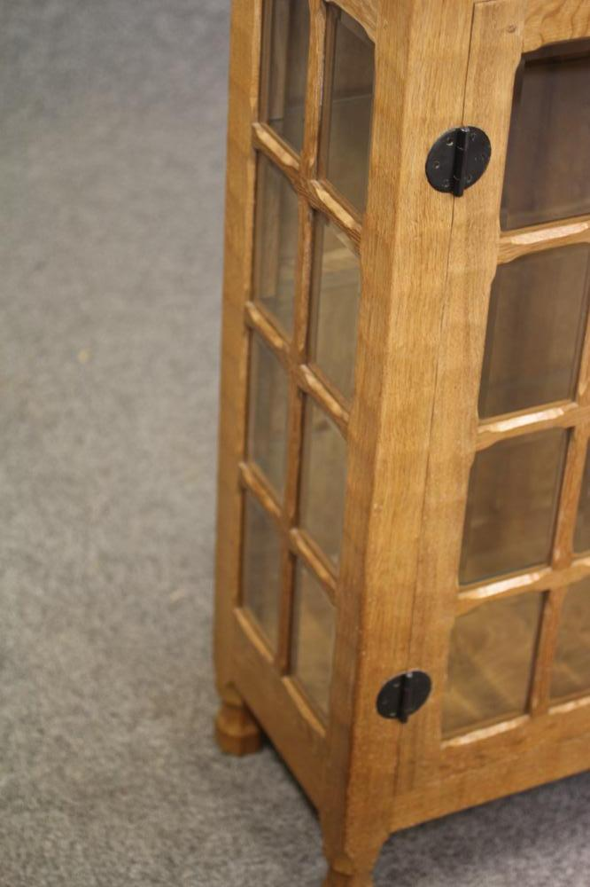 A HORACE KNIGHT (BALK) GLAZED ADZED OAK DISPLAY CABINET, the moulded edged top over two multi - Image 2 of 3