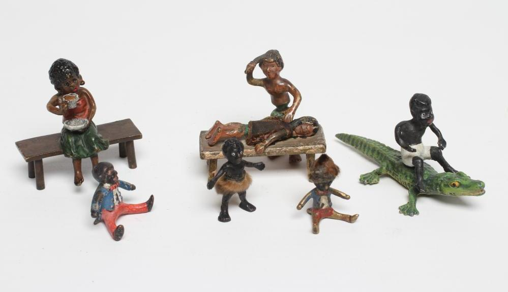 SIX VIENNA TYPE COLD PAINTED BRONZE MINIATURES, comprising a boy seated astride a crocodile, 2 1/