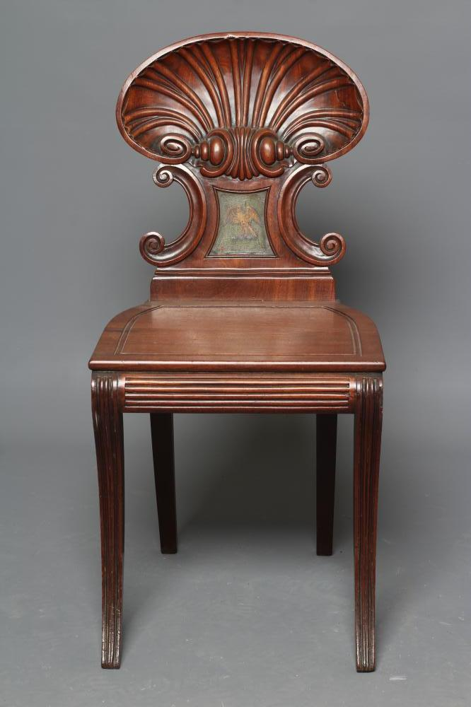 A REGENCY MAHOGANY HALL CHAIR in the manner of Gillow, the shell carved back of C scroll supports