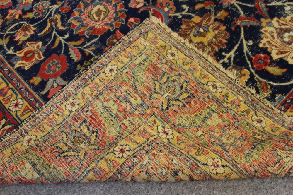 A PERSIAN RUG, the navy blue floral field with similar red and ivory gul, conforming spandrels, - Image 3 of 3