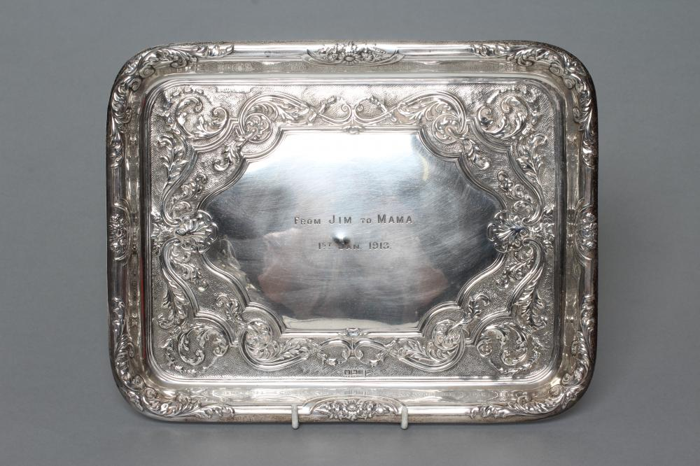 A SILVER DRESSING TABLE TRAY, maker Walker & Hall, Sheffield 1912, of plain rounded oblong form with