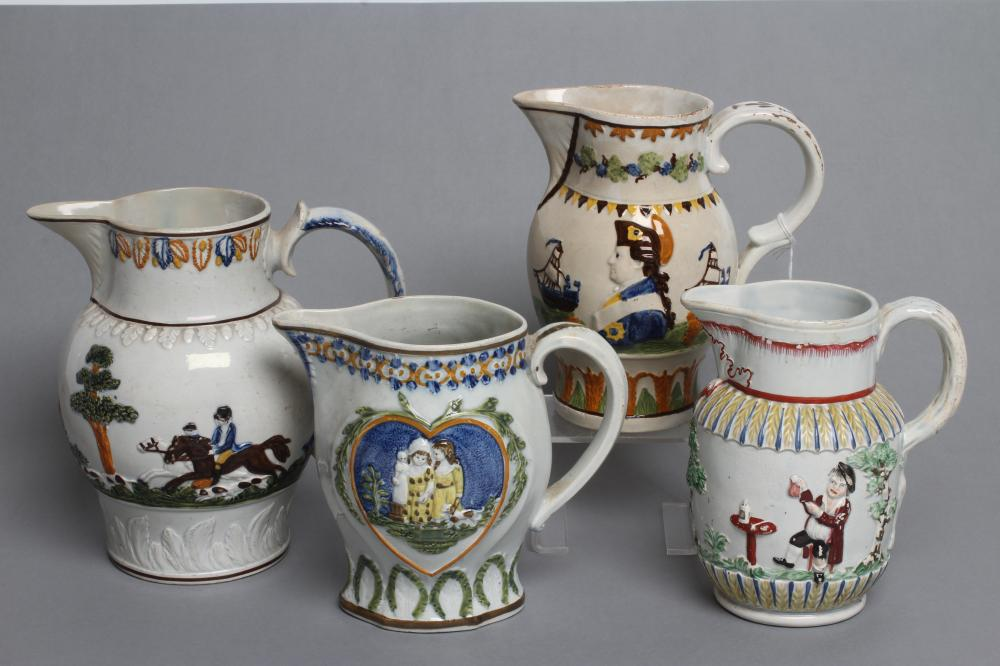 FOUR PRATTWARE JUGS, early 19th century, variously moulded in relief with a bust portrait of Nelson,