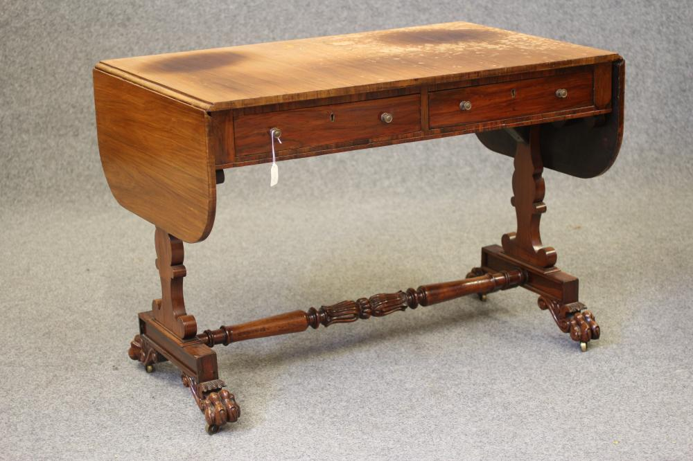 A REGENCY ROSEWOOD SOFA TABLE, the rounded oblong top over frieze with two drawers, with turned