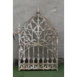 A VICTORIAN CAST IRON PEDESTRIAN GATE, the arched crest with turned finials,