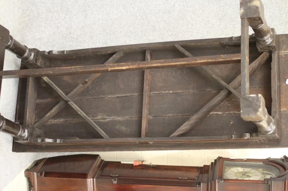A JOINED OAK REFECTORY TABLE, the cleated plank top over twin panelled moulded frieze with - Image 4 of 6
