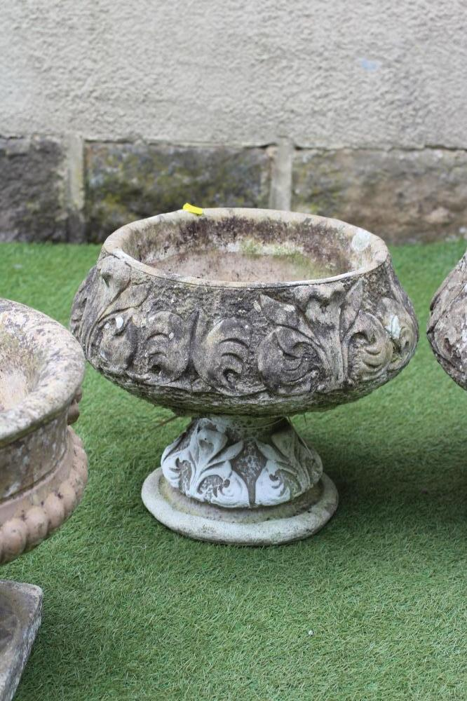 A PAIR OF COMPOSITION STONE URNS, the half fluted circular bowl moulded with flowerheads below a - Image 3 of 3