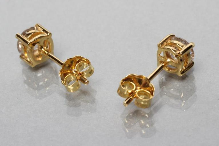 A PAIR OF DIAMOND SOLITAIRE EAR STUDS, each brilliant cut stone of approximately 0.5cts, claw set to - Image 2 of 2