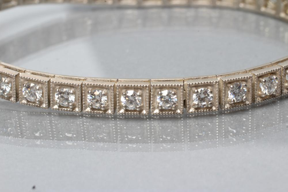 A SILVER TENNIS BRACELET, the thirty six square panels each set with a faceted moissanite, - Image 2 of 2