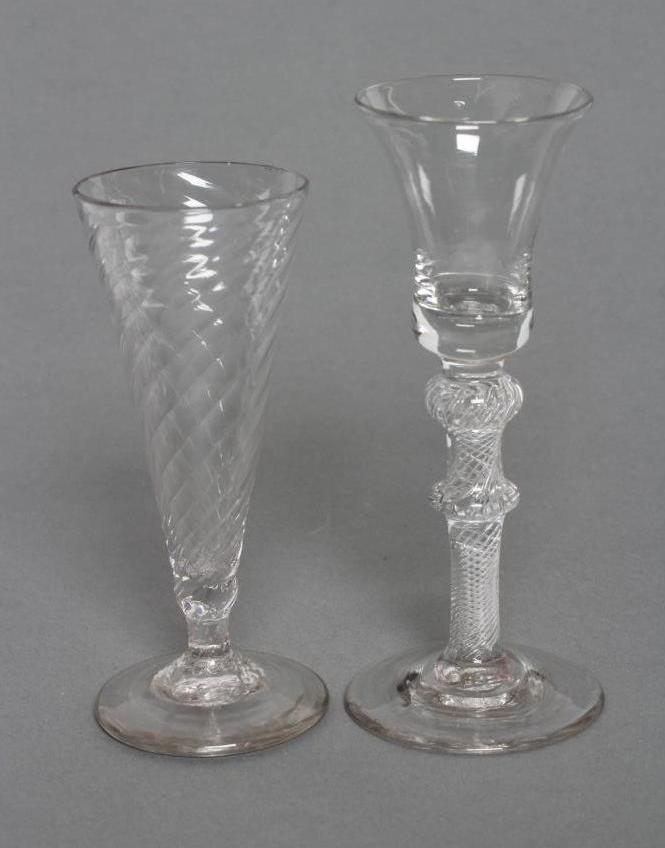 A CORDIAL GLASS, mid 18th century, the plain bell bowl on a single knopped inverted baluster stem