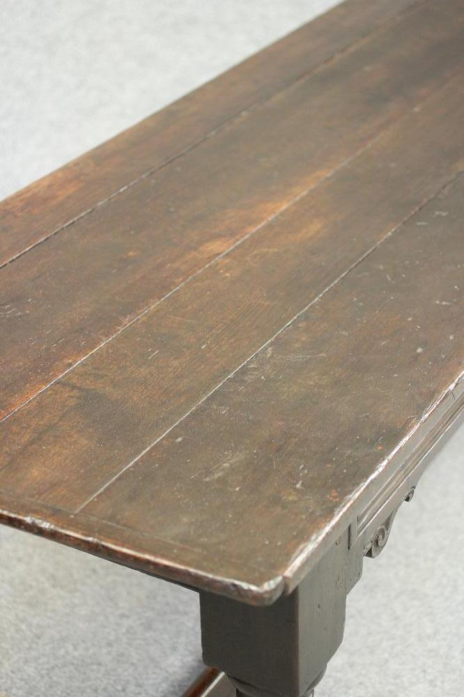 A JOINED OAK REFECTORY TABLE, the cleated plank top over twin panelled moulded frieze with - Image 2 of 6