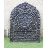 A CAST IRON FIREBACK, possibly 18th century, the arched panel with fruiting vine cresting, central