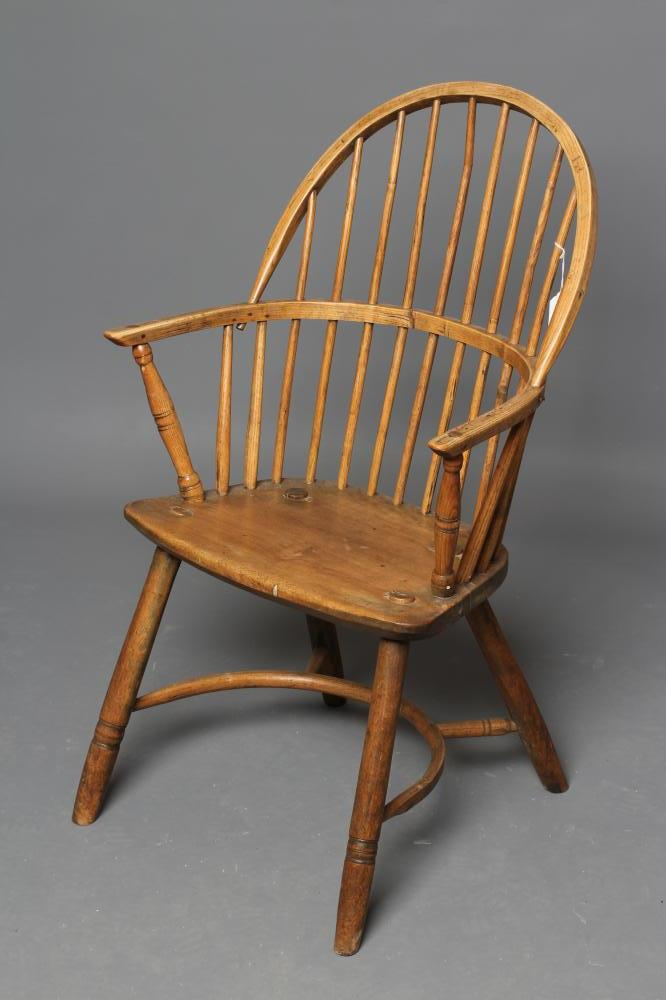 AN ASH STICK BACK WINDSOR ARMCHAIR, early 19th century, the hoop back over bowed seat, baluster