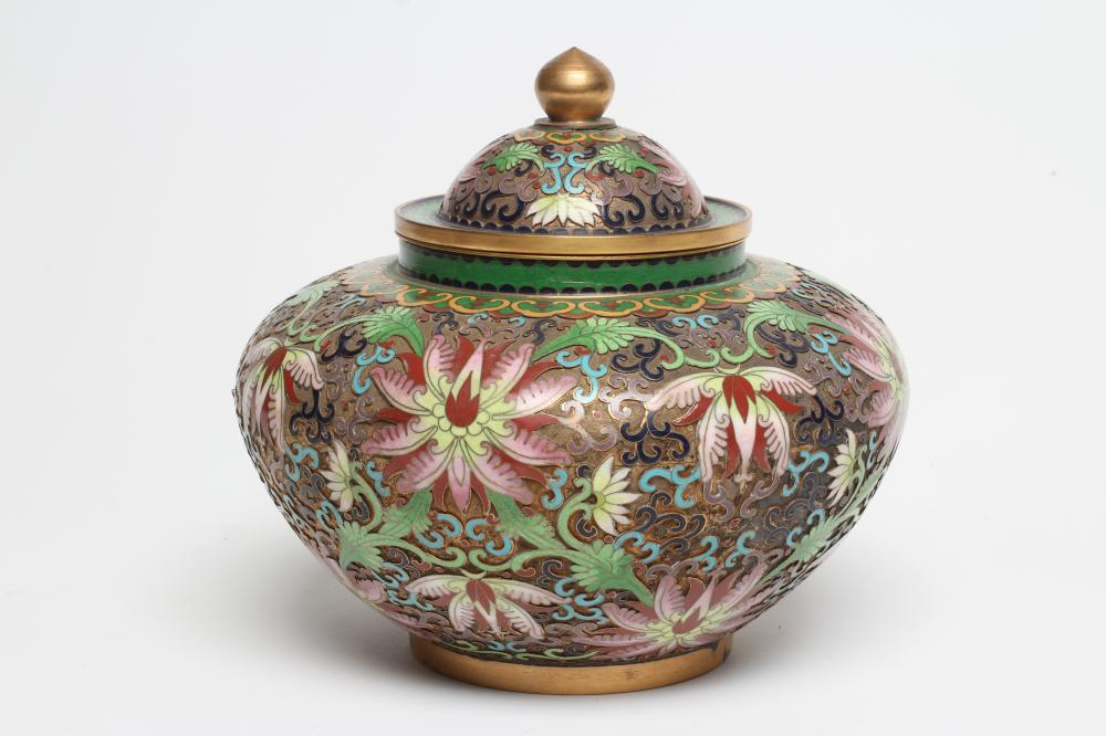 A CHINESE CLOISONNE ENAMEL JAR AND COVER of squat baluster form, the raised brass ground enamelled
