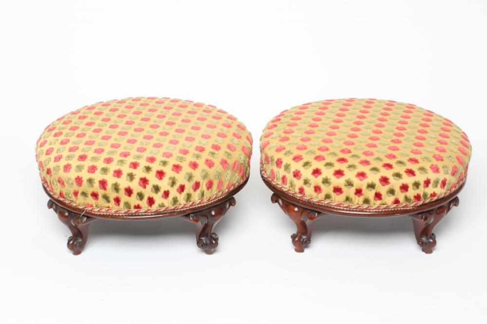 A PAIR OF VICTORIAN MAHOGANY FOOT STOOLS of circular form upholstered in pink, pale green and
