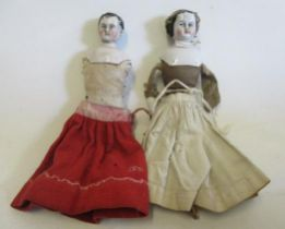 """A china shoulder head doll, with black moulded hair, cloth body and limbs to attach, 8 3/4"""" long,"""