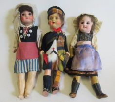 A French socket head fisher doll, with brown glass fixed eyes, closed mouth, five part composition