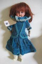 An Armand Marseille bisque shoulder head doll, with blue glass sleeping eyes, open mouth, teeth,