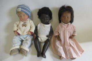 Three Sasha baby dolls, one in its original cardboard tube (Est. plus 21% premium inc. VAT)