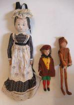 "Three dolls comprising a circa 1900 10"" wooden maid doll, a 8"" felt ""Tod Hunter Elf"" doll, and a 6"