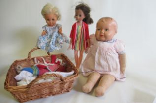 """A composition head doll, with painted features and cloth body, 19"""" long, together with a Uneeda doll"""