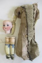 An early Limbach bisque head doll, with blue glass fixed eyes, closed mouth, composite limbs,