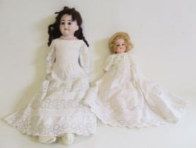 Two bisque shoulder head dolls, comprising a Cuno & Otto Dressel doll with brown glass fixed eyes,