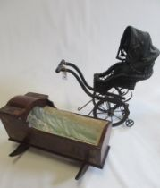 A Victorian style dolls pushchair, with basket enclosed seat, canvas cover and wood and metal frame,