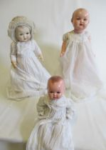 """Two Armand Marseille composition head dolls, comprising a 25"""" socket head numbered 518/7K and a"""