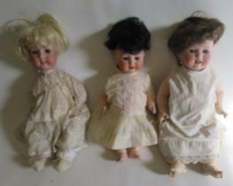 """Three bisque socket head character dolls, comprising a 19"""" Heubach Koppelsdorf with blue glass"""